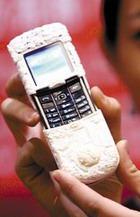 Мобильный телефон в слоновой кости