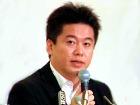 """В Японии основателя интернет-компании """"Livedoor"""" суд приговорил к 2,5 годам заключения"""