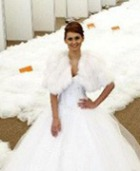 Свадебное платье со шлейфом длиною в 1579 метров будет продано с молотка