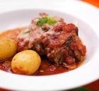 Отбивная говядина в томатном соусе