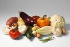 Овощное ассорти с арбузами, айвой и сливами