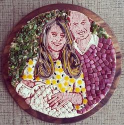 В Британии испекли пиццу с портретом маленькой Шарлотты