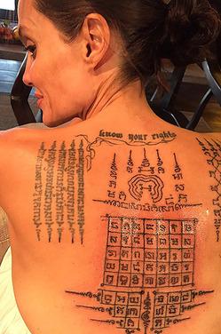 Джоли и Питт пытались спасти семью с помощью священных татуировок